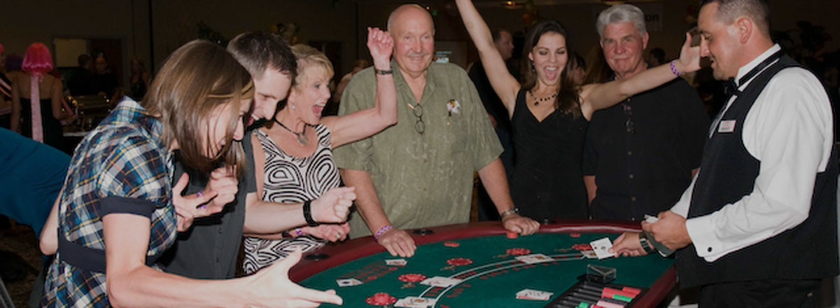 Our satisfied clients enjoying their Seattle Casino Party experience!